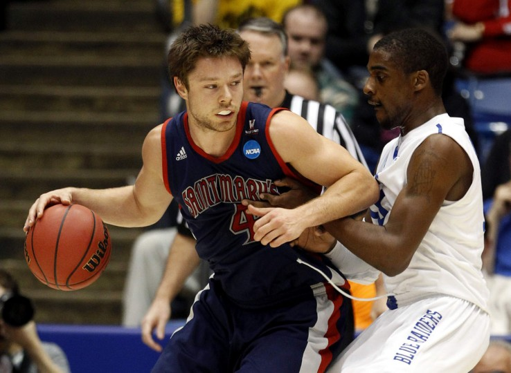 Saint Mary's guard Matthew Dellavedova (L) is pressured by Middle Tennessee guard Bruce Massey (13) during the first half of their first round NCAA tournament basketball game in Dayton, Ohio. (Matt Sullivan/Reuters)