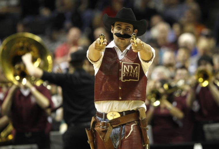 The New Mexico State mascot performs during a timeout during the Aggies NCAA basketball tournament second round game against Saint Louis in San Jose, California March 21, 2013. (REUTERS/Robert Galbraith  )