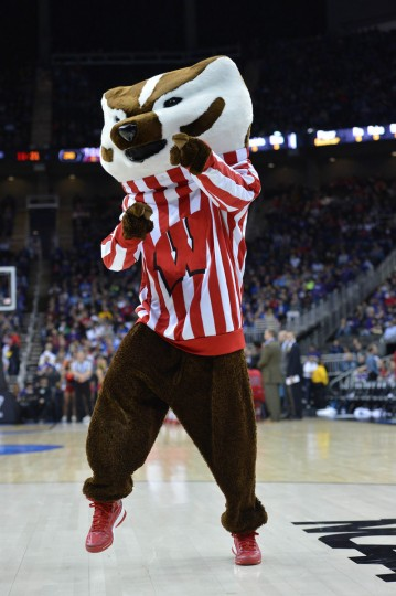 Wisconsin Badgers mascot performs against the Mississippi Rebels guard in the second half during the second round of the 2013 NCAA tournament at the Sprint Center. Mississippi defeated Wisconsin 57-46. (Peter G. Aiken-USA TODAY Sports)
