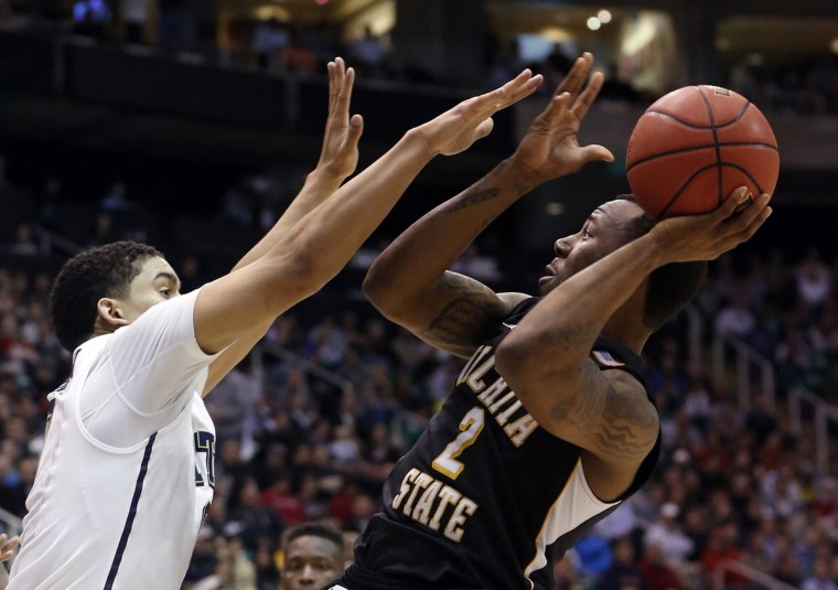 Wichita State guard Malcolm Armstead attempts a shot while defended by Pittsburgh guard James Robinson (0) during the second half of their second round NCAA tournament basketball game in Salt Lake City, Utah, March 21, 2013. (Jim Urquhart/Reuters)