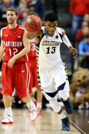 Marquette's Vander Blue steals the ball to end the game in the second half against the Davidson Wildcats during the second round of the 2013 NCAA Men's Basketball Tournament in Lexington, Kentucky. (Andy Lyons/Getty Images)