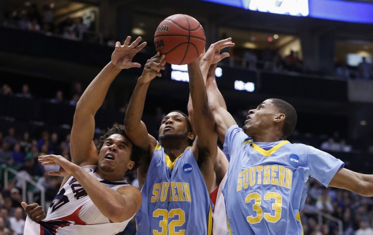 Gonzaga forward Elias Harris battles for a loose ball with Southern University center Brandon Moore and guard Malcolm Miller (33) during the second half of their second round NCAA tournament basketball game in Salt Lake City, Utah, March 21, 2013. (Jim Urquhart/Reuters)