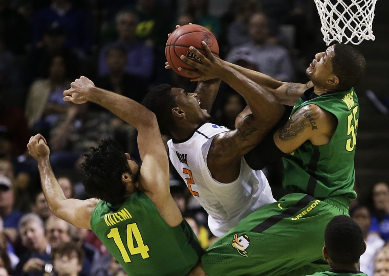 Oklahoma State's Le'Bryan Nash goes up against Arsalan Kazemi and Tony Woods of Oregon Ducks in the second half during the second round of the 2013 NCAA Men's Basketball Tournament in San Jose, California. (Ezra Shaw/Getty Images)