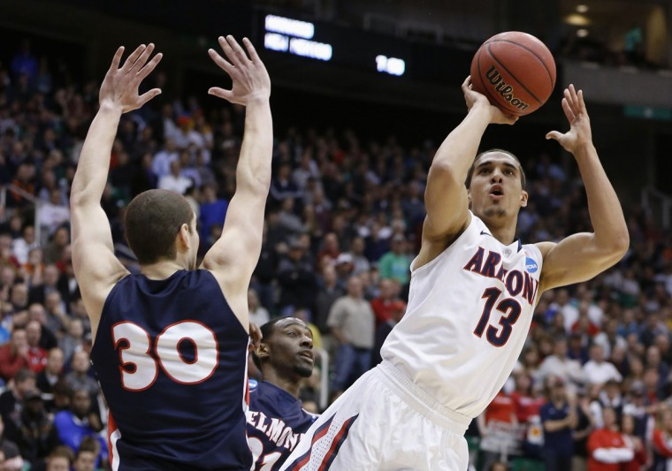 Arizona guard Nick Johnson takes a shot while defended by Belmont forward Trevor Noack during the second half of their second round NCAA tournament basketball game in Salt Lake City, Utah. (Jim Urquhart/Reuters)