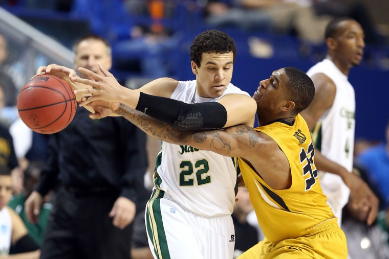 Earnest Ross of the Missouri Tigers knocks the ball away from Colorado State's Dorian Green during the second round of the 2013 NCAA Men's Basketball Tournament in Lexington, Kentucky. (Andy Lyons/Getty Images)