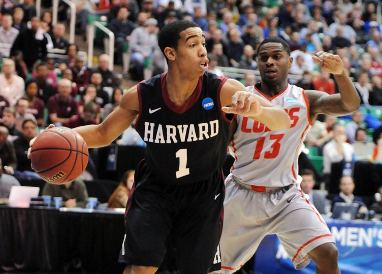 Harvard Crimson guard Siyani Chambers (1) drives past New Mexico Lobos guard Jamal Fenton (13) in the second half of the game during the second round of the 2013 NCAA tournament in Salt Lake City. (Steve Dykes/USA TODAY Sports)