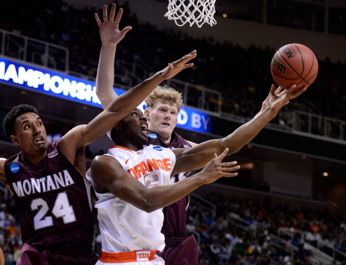 Syracuse's C.J. Fair drives to the basket against Spencer Coleman and Eric Hutchison of Montana in the first half during the second round of the 2013 NCAA Men's Basketball Tournament in San Jose, California. (Thearon W. Henderson/Getty Images)