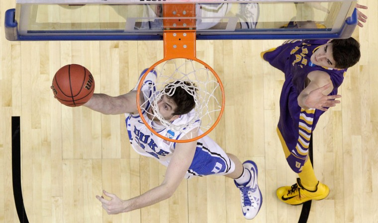 Duke's Ryan Kelly puts up a shot in front of Sam Rowley of Albany during the second round of the 2013 NCAA Men's Basketball Tournament on March 22, 2013 in Philadelphia. (Rob Carr/Getty Images)