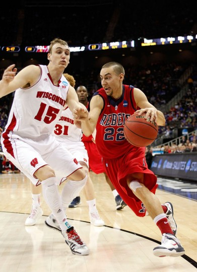 Mississippi guard Marshall Henderson drives against Wisconsin's Sam Dekker in the first half during the second round of the 2013 NCAA Men's Basketball Tournament on March 22, 2013 in Kansas City, Missouri. (Ed Zurga/Getty Images)