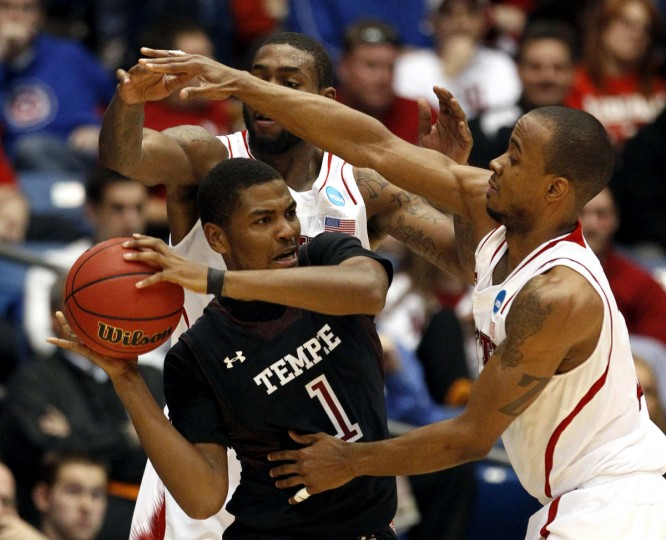 Temple guard Khalif Wyatt (1) is fouled by North Carolina State defenders Richard Howell (L) and Lorenzo Brown during the second half of their second round NCAA tournament basketball game in Dayton, Ohio March 22, 2013. (Matt Sullivan/Reuters)