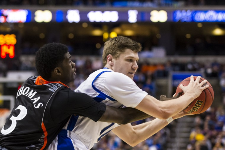 Creighton guard Grant Gibbs is defended by Cincinnati forward Shaquille Thomas during the second half during the second round of the 2013 NCAA tournament in Philadelphia. (Howard Smith/USA TODAY Sports)