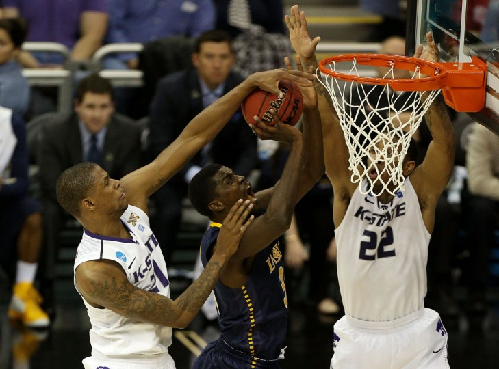 La Salle's Rohan Brown shoots against Jordan Henriquez and Rodney McGruder of Kansas State in the second half during the second round of the 2013 NCAA Men's Basketball Tournament in Kansas City, Missouri. (Ed Zurga/Getty Images)