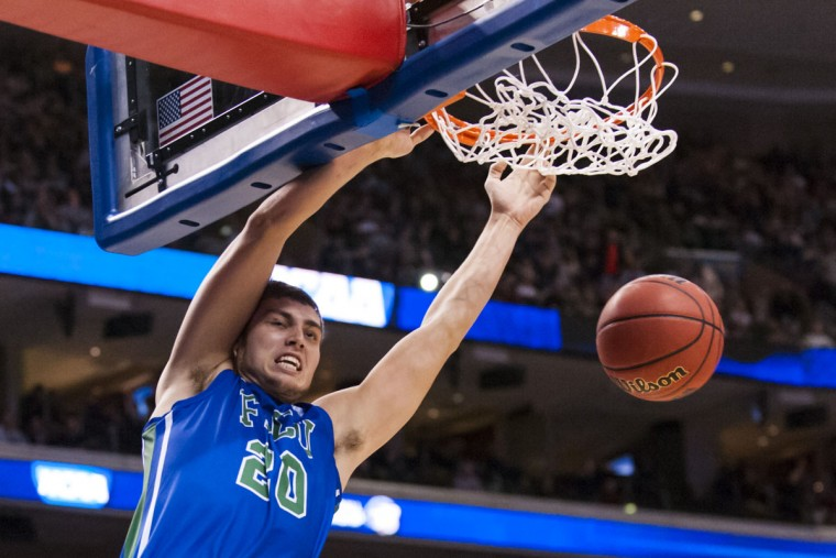 Florida Gulf Coast forward Chase Fieler dunks during the second half against Georgetown in the second round of the 2013 NCAA tournament in Philadelphia. (Howard Smith/USA TODAY Sports)