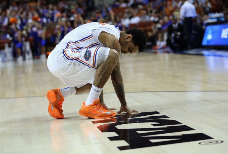 Florida's Scottie Wilbekin touches the court during a game against Northwestern State during the second round of the 2013 NCAA Men's Basketball Tournament on March 22, 2013 in Austin, Texas. (Ronald Martinez/Getty Images)