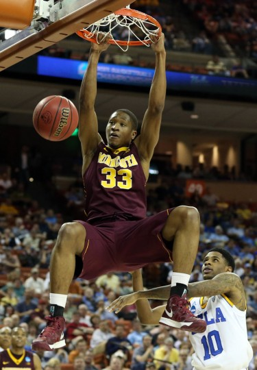 Minnesota forward Rodney Williams dunks the ball in front of UCLA guard Larry Drew II during the second half in the second round of the 2013 NCAA tournament in Austin, Texas. (Jim Cowsert/USA TODAY Sports)