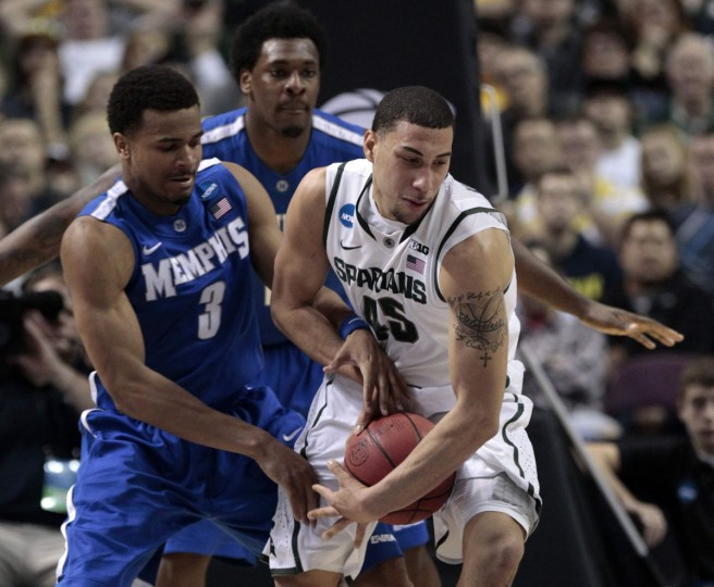 Michigan State's Denzel Valentine is defended by Memphis Tigers' Chris Crawford during the second half of their third round NCAA tournament basketball game in Auburn Hills, Michigan March 23, 2013. (Jeff Kowalsky/Reuters)