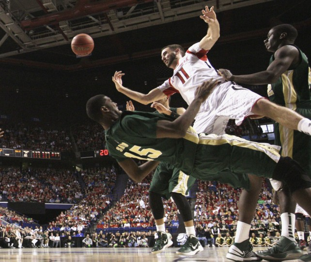 Louisville's Luke Hancock fights to get his shot off under pressure from Colorado State's Gerson Santo during the second half of their third round NCAA basketball game in Lexington, Kentucky, March 23, 2013. (John Sommers II/Reuters)