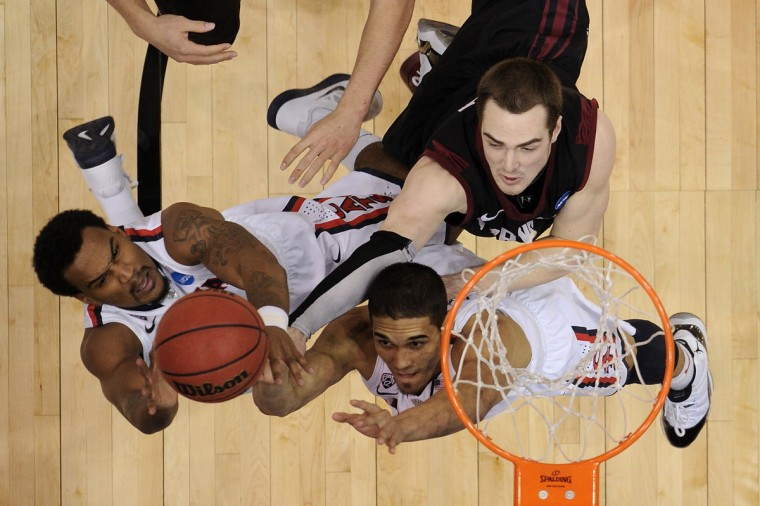 Arizona's Jordin Mayes and Nick Johnson go after the ball in front of Havard's Laurent Rivard during the third round of the 2013 NCAA Men's Basketball Tournament on March 23, 2013 in Salt Lake City, Utah. (Harry How/Getty Images)