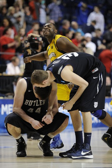 Butler Bulldogs forward Emerson Kampen consoles center Andrew Smith while a Marquette player celebrates in the background after the third round of the NCAA basketball tournament in Lexington, Ky. (Jamie Rhodes/USA TODAY Sports)