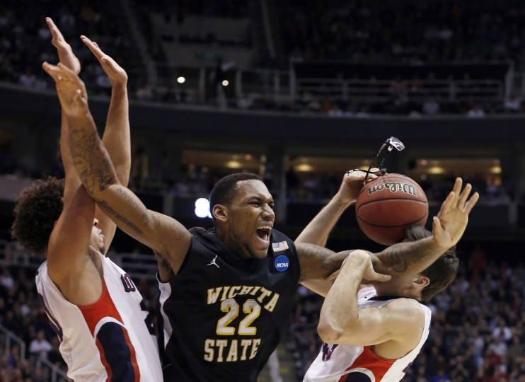 Wichita State forward Carl Hall loses his glasses while being defended by Gonzaga forward Elias Harris and guard Drew Barham during the second half of their third round NCAA tournament basketball game in Salt Lake City. (Jim Urquhart/Reuters)