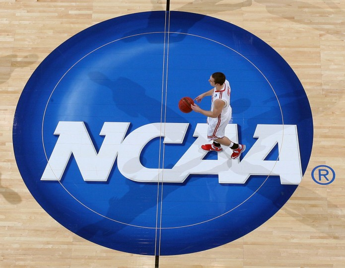 Ohio State guard Aaron Craft brings the ball up court across the NCAA logo in a game against Iowa State during the third round of the 2013 NCAA tournament in Dayton, Ohio. (Brian Spurlock/USA TODAY Sports)
