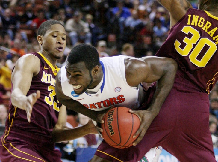 Florida center Patric Young, middle, fights between Minnesota defenders during the third round of the NCAA Tournament at the Frank Erwin Center in Austin, Texas, on Sunday, March 24, 2013. (Stephen M. Dowell/Orlando Sentinel/MCT Photo)