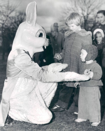 Jim Stack, dressed as the Easter Bunny, greets 7-year-old Ida Ruth and 2-year-old Neil Potter during an Easter egg hunt at Patterson Park in 1958. (Ellis Malashuk, The Baltimore Sun)