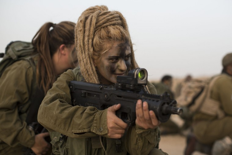 A soldier from the 'Karakal' Battalion during a graduation march near the Israeli-Egyptian border on March 13, 2010 near Azoz, Israel. The Karakal is a mixed-sex battalion formed in 2004, with men and women serving together in this combat unit, based in the Negev desert on the borders with Egypt and Jordan. (Ilia Yefimovich/Getty Images)
