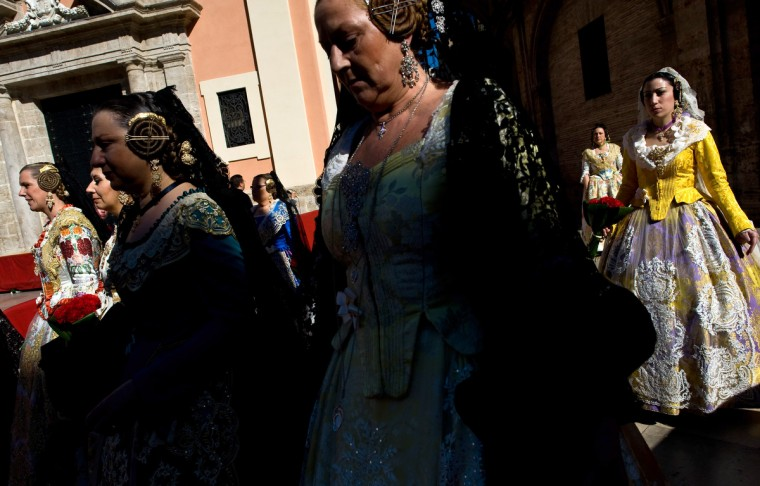 Falleras dressed in traditonal costume during a procession to deliver flowers to Saint Mary in Valencia, Spain. The Fallas festival, which runs from March 15 until March 19, celebrates the arrival of spring with fireworks, fiestas and bonfires made from large ninots (puppets). ((David Ramos/Getty Images)