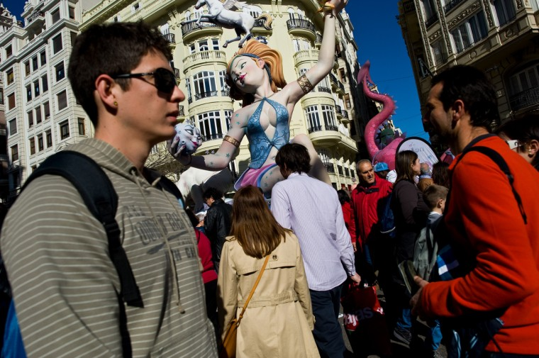 People walk past a Falla in Valencia, Spain. The Fallas festival, which runs from March 15 until March 19, celebrates the arrival of spring with fireworks, fiestas and bonfires made from large ninots (puppets). (David Ramos/Getty Images)