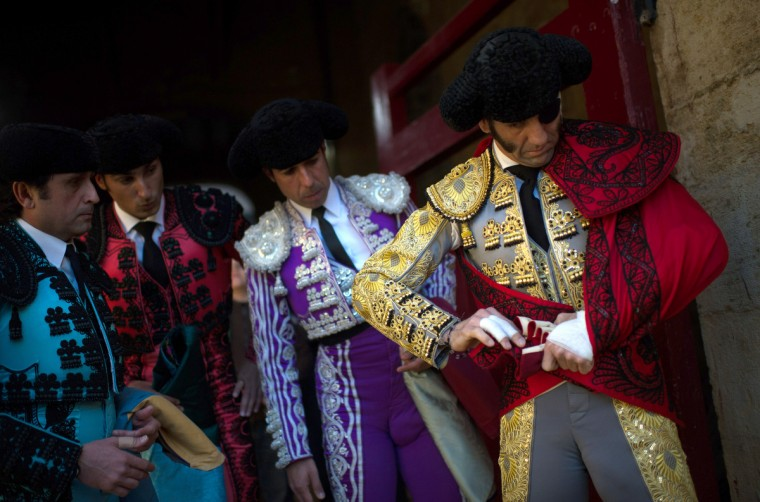 Bullfighter Juan Jose Padilla (R) puts on his costume with help from his assitants before a bullfight as part of the Las Fallas Festival in Valencia, Spain. The Fallas festival, which runs from March 15 until March 19, celebrates the arrival of spring. (David Ramos/Getty Images)