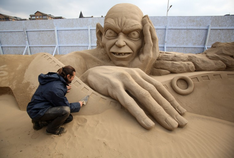 Sand sculptor Radavan Zivny works on a sand sculpture of Gollum as pieces are prepared as part of this year's Hollywood themed annual Weston Sand Sculpture festival in Weston-Super-Mare, England. Due to open on Good Friday, currently twenty award winning sand sculptors from across the globe are working to create sand sculptures including Harry Potter, Marilyn Monroe and characters from the Star Wars films as part of the town's very own movie themed festival on the beach. (Matt Cardy/Getty Images)