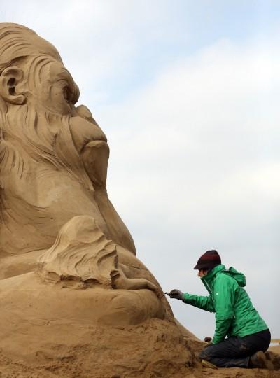 Sand sculptor Helena Bangert, from Holland works on a sand sculpture of King Kong. (Matt Cardy/Getty Images)