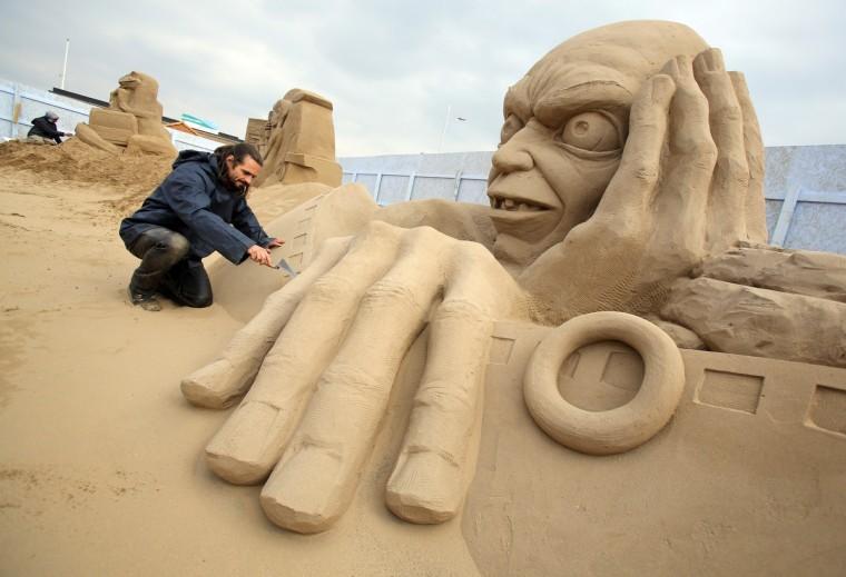Sand sculptor Radavan Zivny works on a sand sculpture of Gollum. (Matt Cardy/Getty Images)