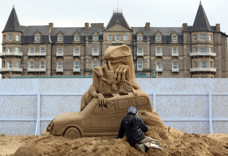A sand sculptor works on a Jurassic Park themed sand sculpture as pieces are prepared as part of this year's Hollywood themed annual Weston-super-Mare Sand Sculpture festival. (Matt Cardy/Getty Images)