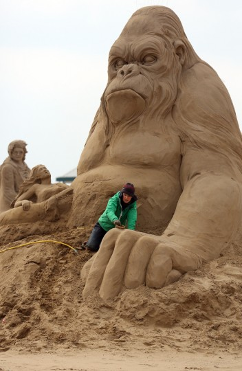 Sand sculptor Helena Bangert (C), from Holland works on a sand sculpture of King Kong. (Matt Cardy/Getty Images)