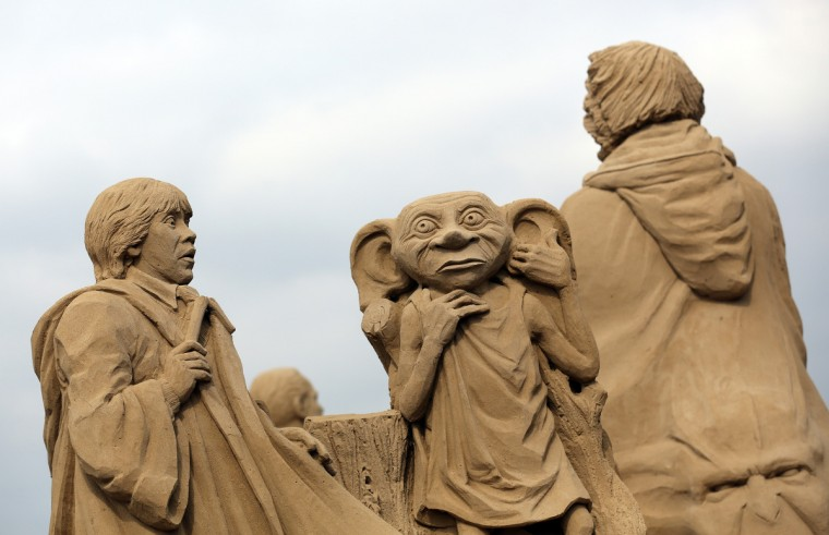 A detail of a sand sculpture of Harry Potter is seen as pieces are prepared as part of this year's Hollywood themed annual Weston-super-Mare Sand Sculpture festival. (Matt Cardy/Getty Images)