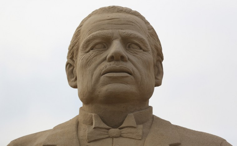 A sand sculpture of Marlon Brando in The Godfather is seen as pieces are prepared as part of this year's Hollywood themed annual Weston-super-Mare Sand Sculpture festival. (Matt Cardy/Getty Images)