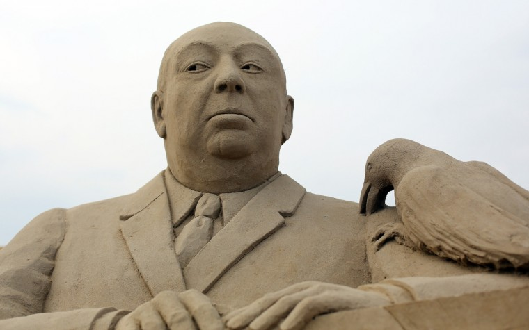 A sand sculpture of Alfred Hitchcock is seen as pieces are prepared as part of this year's Hollywood themed annual Weston-super-Mare Sand Sculpture festival.