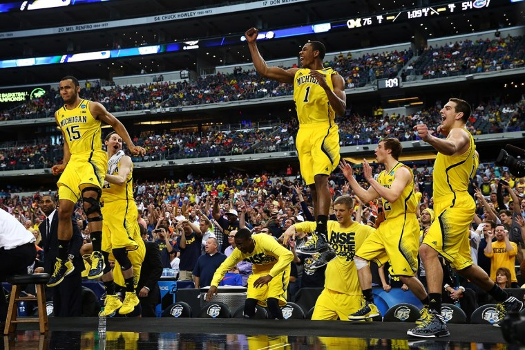 The Michigan Wolverines bench celebrates their 79 to 59 win over the Florida Gators during the South Regional Round Final of the 2013 NCAA Men's Basketball Tournament at Dallas Cowboys Stadium on March 31, 2013 in Arlington, Texas. (Photo by Tom Pennington/Getty Images)