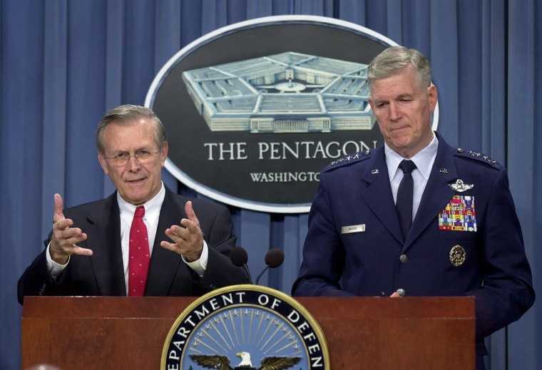 """Secretary of Defense Donald Rumsfeld (L) and the Chairman of the Joint Chiefs of Staff General Richard Myers at the Pentagon March 20, 2003 in Arlington, Virginia. Rumsfeld spoke about the onset of hostilities between U.S. led coalition forces and Iraq, saying that the """"days of the Saddam Hussein regime are numbered."""" (Stefan Zaklin/Getty Images)"""