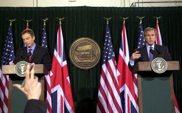 U.S. President George W. Bush (R) and British Prime Minister Tony Blair speak during a news conference at Camp David following their talks on the progress of the war in Iraq March 27, 2003 in Thurmont, Maryland. (Ron Sachs-Pool/Getty Images)