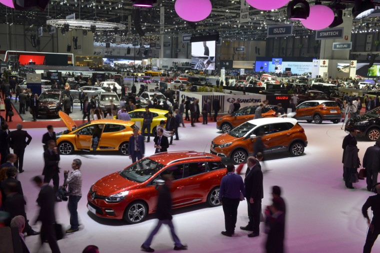 People visit the Geneva International Motor Show on March 5, 2013 which opens its doors today under a dark cloud, with no sign of a speedy rebound in sight for the troubled European market. T(Sebastein Feval/Getty Images)