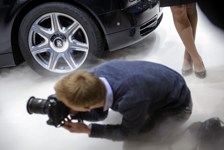 A photographer snaps pictures at the Rolls Royce car maker's booth on March 5, 2013 on the press day of the Geneva car Show in Geneva. (Fabrice Coffrini/Getty Images)