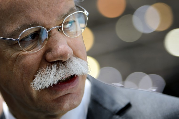 Daimler CEO Dieter Zetsche looks on at the Mercedes Benz car maker's booth on March 5, 2013 on the press day of the Geneva car Show in Geneva. (Fabrice Coffrini/Getty Images)