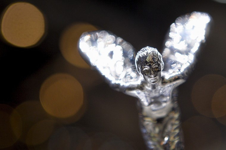 "The Rolls-Royce's iconic mascot ""the Spirit of Ecstacy"" is pictured on the bonnet of the new Rolls Royce Wraith model car displayed as World premiere at the British carmaker's booth on the press day of Geneva car Show, in Geneva. (Fabrice Coffrini/Getty Images)"
