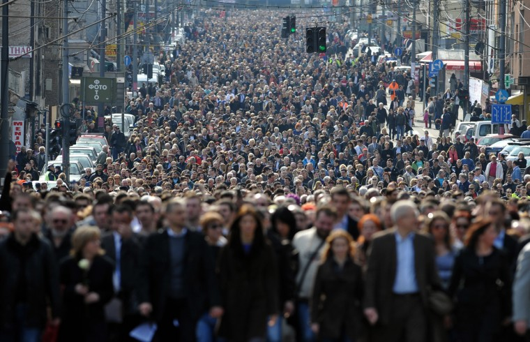 More than 15,000 people march in silence in Belgrade, marking the 10th anniversary of murder of Prime Minister Zoran Djindjic, the first democratically elected Prime Minister in post-communist Serbia. Djindjic was shot and killed by a single sniper in broad daylight at the doorstep of a Serbian government building. (Andrej Isakovic/Getty Images)