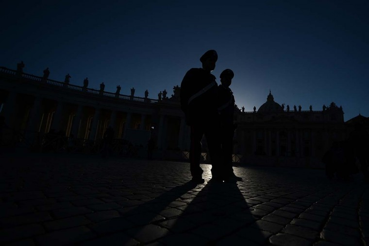 Italian carabinieri policemen walk at St Peter's square on March 18, 2013 at the Vatican, on the eve of Pope Francis inauguration mass. The leader of the world's 1.2 billion Catholics will be formally enthroned tomorrow at a mass in St Peter's Square, with city authorities preparing for an influx of up to a million people to Rome. (Flippo Monteforte/AFP/Getty Images)
