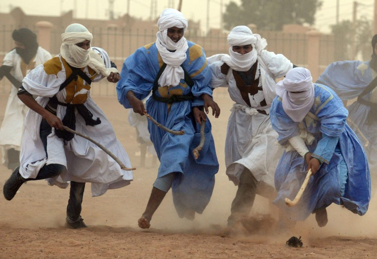 Nomads vie for the ball during a match of nomad hokey, played on sand, in the Moroccan desert in M'hamid El Ghizlane, southeast of Zagora. (Fadel Senna/Getty Images)