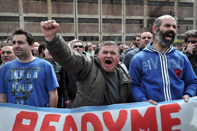 Greek shipyards workers, many of them without any income for months , march to the Merchant ministry in the port of Piraeus, during their protest rally. Shipyard workers are taking industrial action for months, over delayed payments and soaring unemployment in their sector . (Louisa, Gouliamaki/Getty Images)